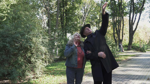 Mature couple admire nature in the park Footage