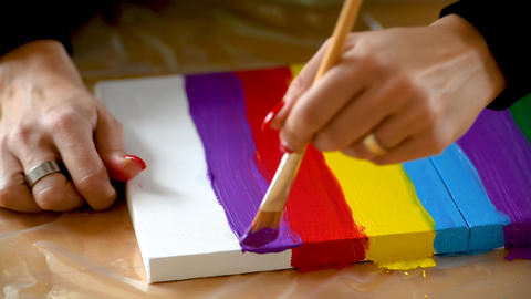 Painting rainbow on canvas, gay pride, transsexuality concept Photo