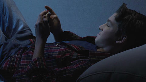 Teenager checking social networks instead sleeping at night, internet addiction Footage