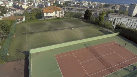 Rich people playing tennis at luxury court, leisure activities, sport weekend Live Action