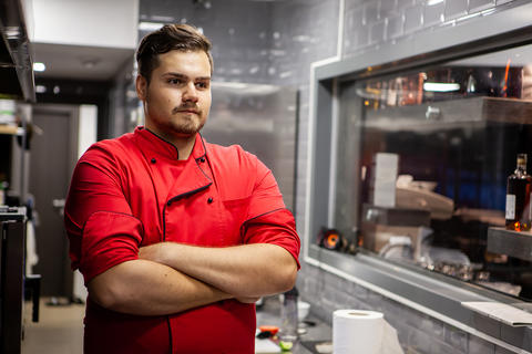 Portrait of male cook chef in kitchen Photo