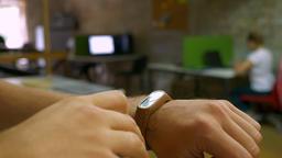 Focused hand of man in fitness bracelet, whitening kit in office, office Footage