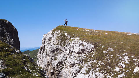 man doing trekking in the mountains, walking to the top, Alta Badia mountains Footage