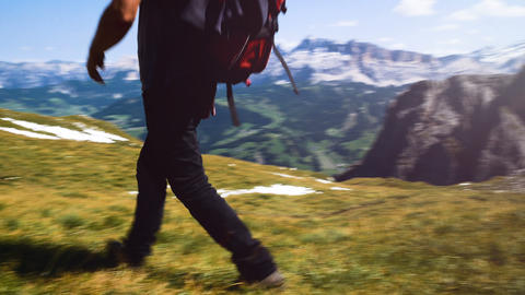 man doing trekking in the mountains, walking to the top, Alta Badia mountains Live Action