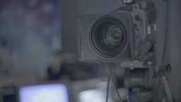 The camera is pointed at the target shooting in the TV Studio Footage