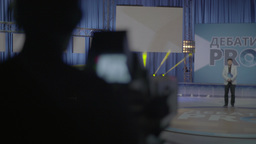 The cameraman shoots TV presenter in the TV Studio Footage