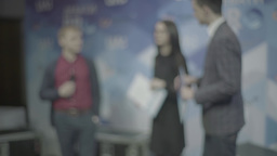 Silhouettes of people in a TV Studio during an interview Footage