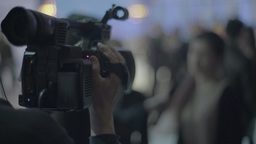 The camera is in the hands of the cameraman shoots report Footage