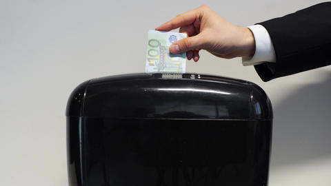 Businessman puts false marked euros into shredder Footage