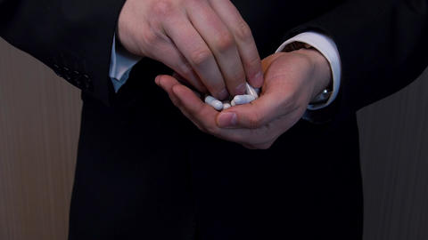 Man in suit swallows a lot of pills Footage