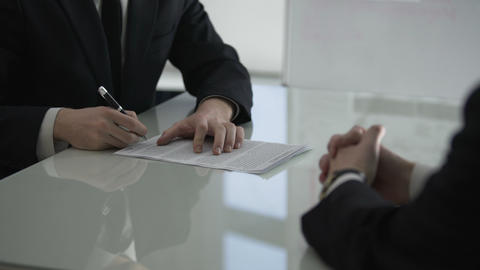 Businessman giving male colleague cooperation contract for signing, partnership Footage