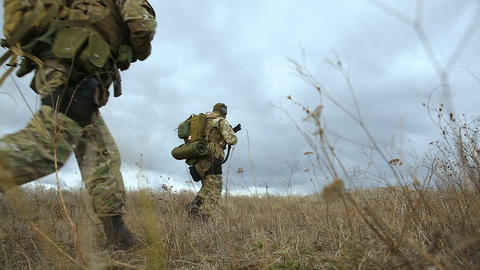 Armed soldiers running forward to attack Live Action