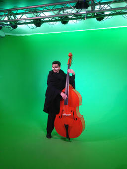 Contrabass Player Playing Classical Music on Chroma Key Wall Fotografía