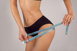 Fit Sportswoman Measuring Hips Buttocks Size フォト
