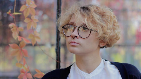 Beauty portrait, beautiful caucasian blonde woman in glasses, looking at camera Footage