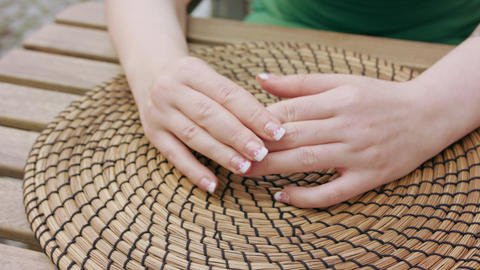 Close-up of a Lady's Hands on the Table GIF