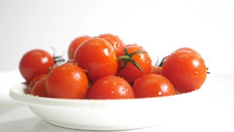 Enchanted Tomatoes Rotating On White Background Animation