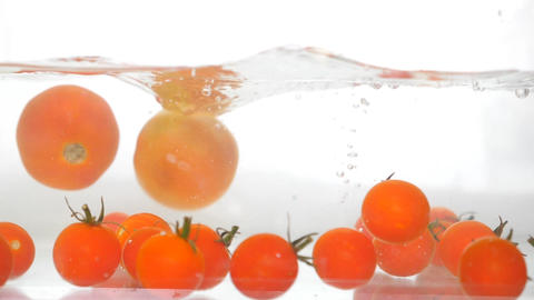 Falling Tomatoes Rotating On White Background Magic Animation