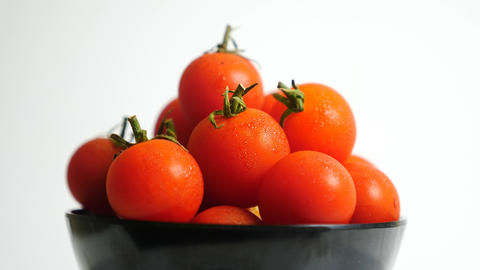 Fresh red tomatoes and chopped tomato are on the rotating…, Stock Animation