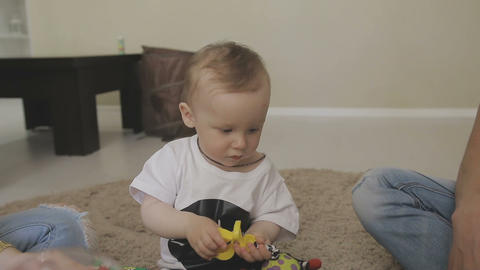 Father and mother are playing with their little child. Family at home Footage