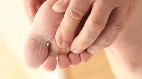 Man massaging the sole of his foot Footage