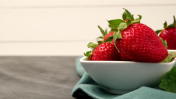 Appetizing strawberry in the bowl Live Action