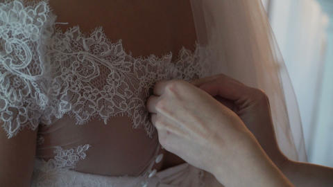 The bride is fastening a wedding dress Footage