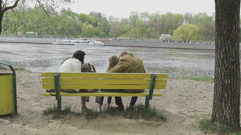 Family walks on the river bank in warm weather Live Action