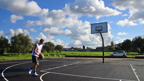 Basketball player driving to the hoop in an outdoor court Footage