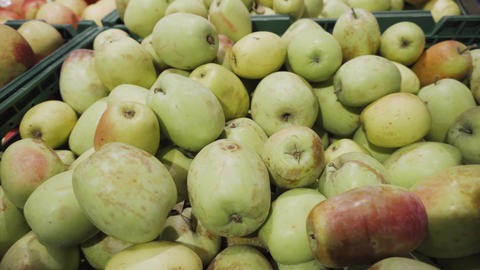 A bunch of green apples piled up at the supermarket Footage