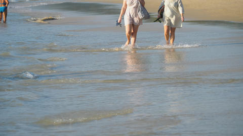 Barefoot beach walking Live Action