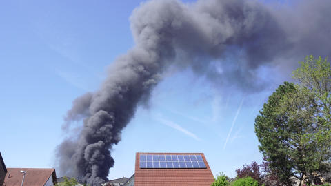 Large Black Smoke Clouds, Fire in Town Footage