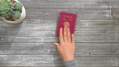 People placing US and Japanese passports on a desk GIF