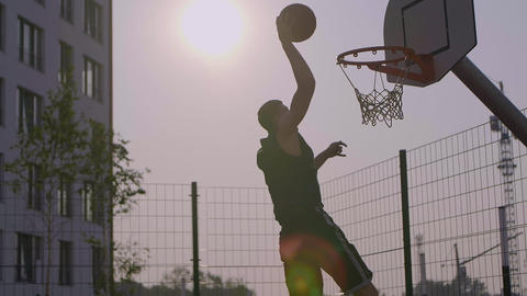 Young man scored a ball in basketball hoop outdoor 영상물