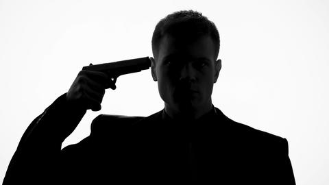 Man pointing gun to head, suicide thoughts, in despair because of debt, taxes Live Action