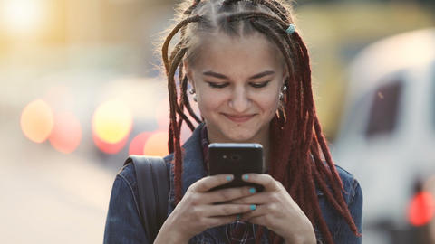 Girl Texts in Street Live Action