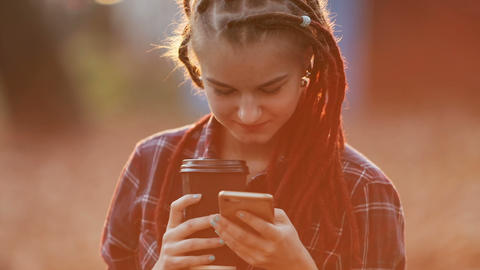 Girl Texts Message in Sunset Live Action