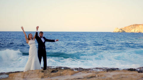 Happy Bride and groom on the seashore on their wedding day. Happy honeymoon Live Action