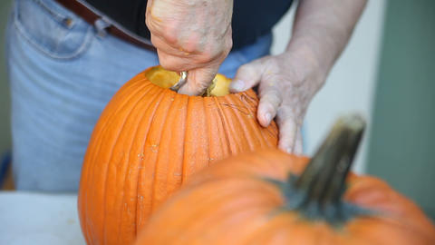 Cleaning out Halloween pumpkin before carving Footage