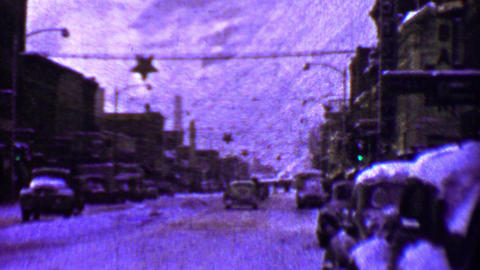 1957: Downtown winter snow filled streets Alaskan cityscape Footage