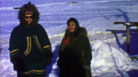 1957: Native embroidered winter cold weather fur coats in snowscape Footage