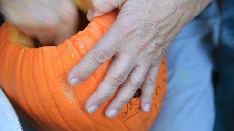 Scraping inside a Halloween pumpkin Footage