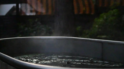 Hot herbal bath and steam over water closeup. Spa, sauna, skin and body care Live Action
