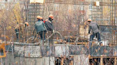 Workers at the construction site pour concrete Footage