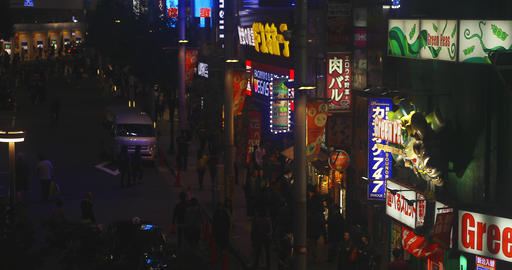 Neon boards beside the street 4K high angle ビデオ