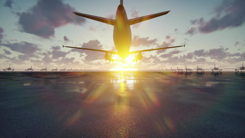 Plane takes off at sunrise or sunset background in slow motion CG動画素材