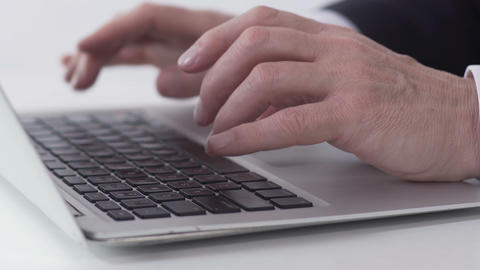 Hardworking office manager typing e-mail and sending it to boss, hands close-up Live Action
