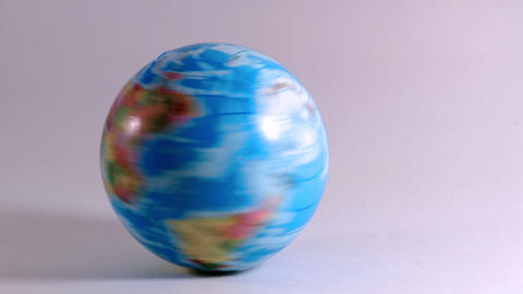 globe is rotated hard by a hand of a man, symbolizes ecological problems Live Action