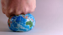 world globe is crushed by a man's fist, ecological problems Live Action