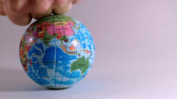 world globe is crushed by a man's fist, ecological problems Stock Video Footage